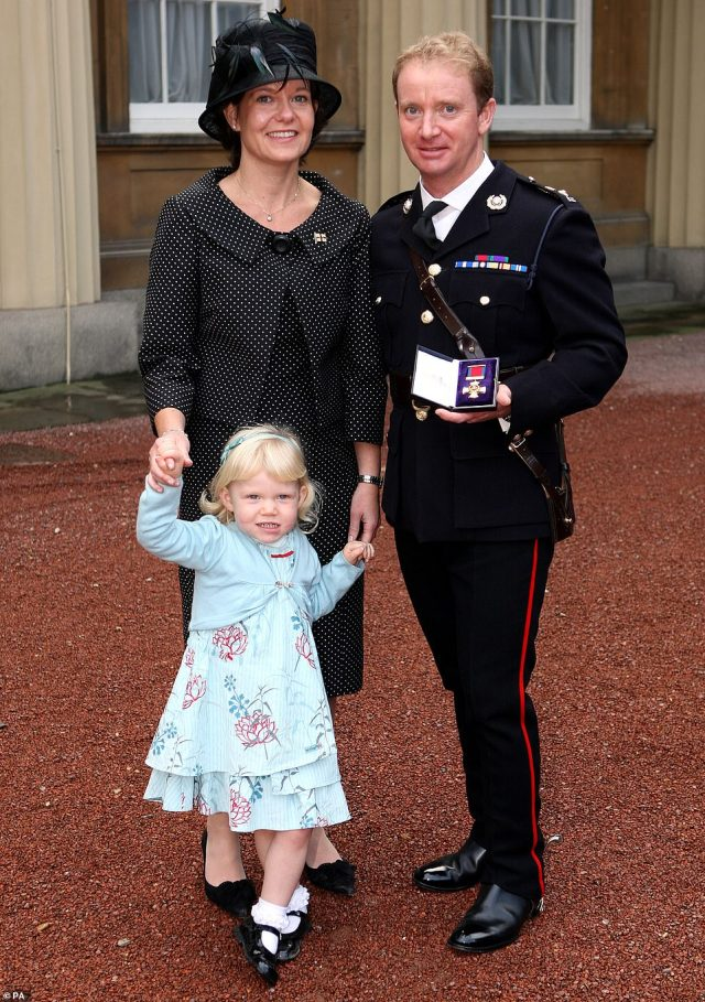 The widow of the former head of the Royal Marines who took his own said her husband was 'exceptionally proud' to have served as the commandant general of the fighting unit. In a statement, Lea Holmes paid tribute to her husband, Major General Matthew Holmes, 54, who was removed from his role in April just 20 months into a what was meant to be a three-year stint. Above: Major General Holmes with his wife and daughter at Buckingham Palace in 2007 after being awarded the Distinguished Service Order for his leadership on the frontline in Afghanistan