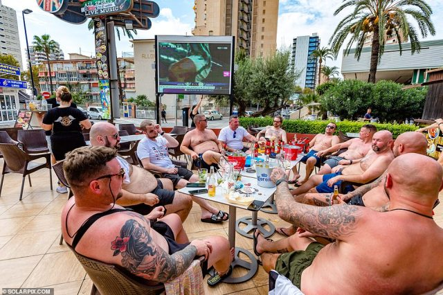 Sun-starved Britons are flooding back to Benidorm with the regular sight of lager bottles and topless holidaymakers reappearing in the Costa Blanca hotspot