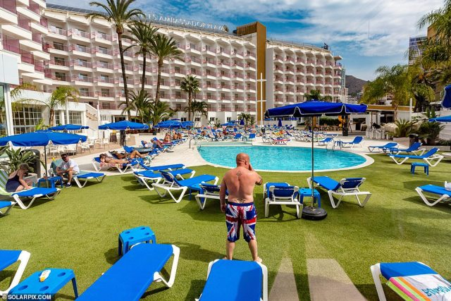 A British tourist stands in his patriotic swimming shorts at the Hotel Ambassador Playa in the sun as the coastal town seeks to revive its economy