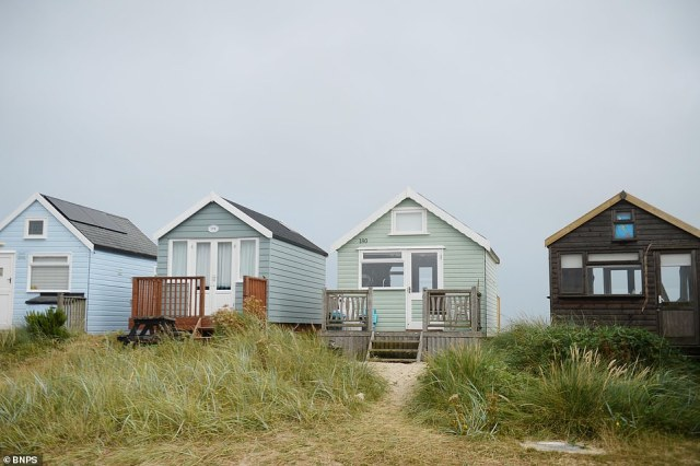 Pictured: The green beach hut, number 180, at Mudeford Sandbank in Dorset