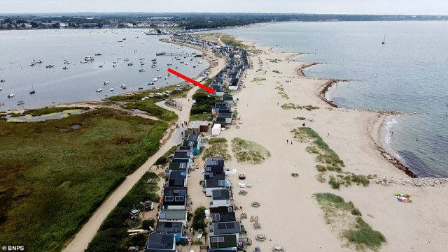 Pictured: The beach hut on Mudeford Sandbank with the red arrow pointed at it