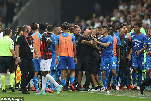 Marseille coach Jorge Sampaoli gets dragged away during their match against Nice