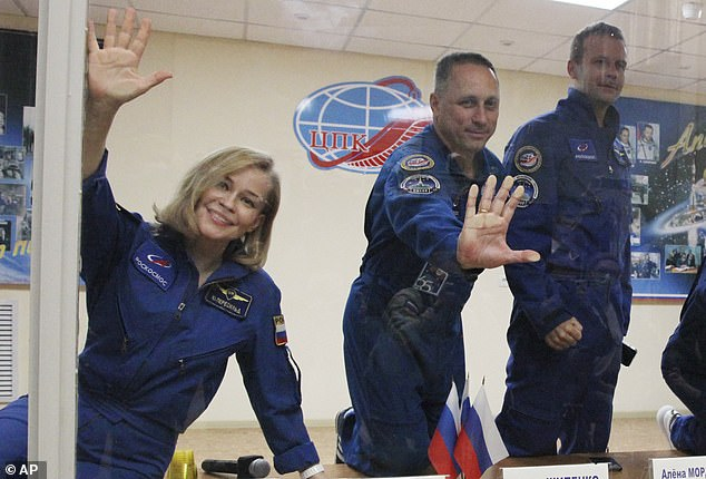 The actress (late) and director (right) will launch from Baikonur Cosmodrome on a Soyuz MS-19 crew capsule at 09:55 BST (04:55 ET) with cosmonaut Anton Shkaplerov (center).