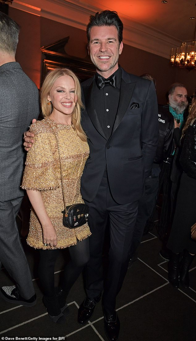 Long-distance lovers:Kylie Minogue's (left) boyfriend Paul Solomons (right) has decided not to move to Australia with the singer, a new report claims