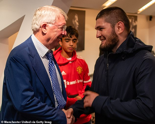 Sir Alex Ferguson (left) appeared to tell Khabib Nurmagomedov (right) that he disagreed with Ole Gunnar Solskjaer's decision to bench Cristiano Ronaldo last week.