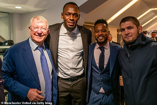 Khabib (right) was seen in United's executive box alongside Ferguson, Usain Bolt and Patrice Evra (left to right).