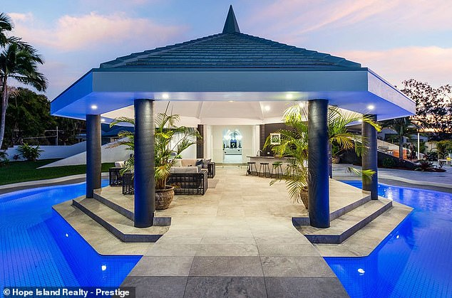 Amazing:Despite removing the indoor pool, there's still a 47m tiled swimming pool outside which wraps around an outdoor entertaining pavilion with a granite bar