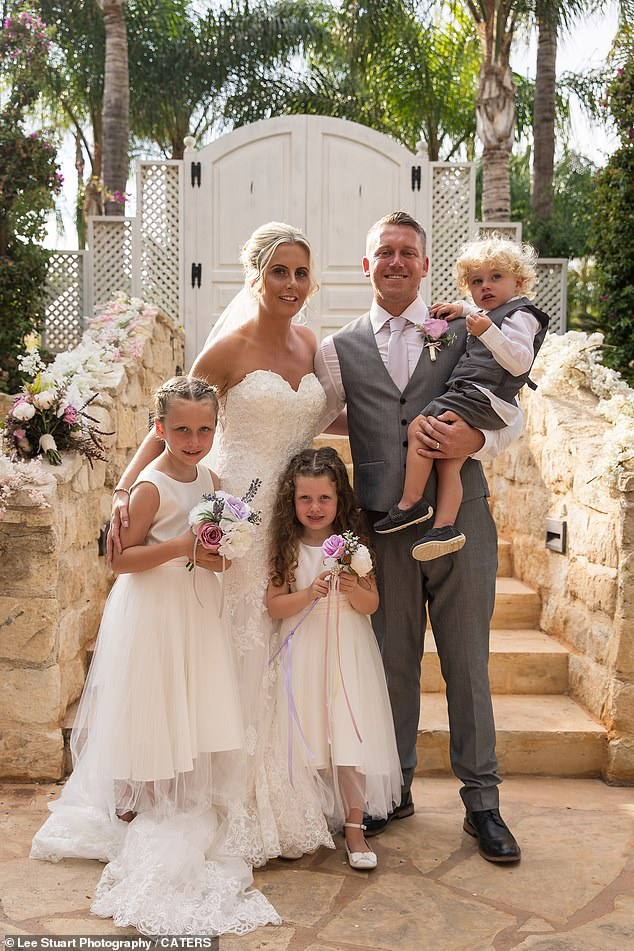 A family photo at Kelly and Billy's wedding.  In addition to the twins, the couple has three grown children (from left to right) Phoebe, Florence and Albert