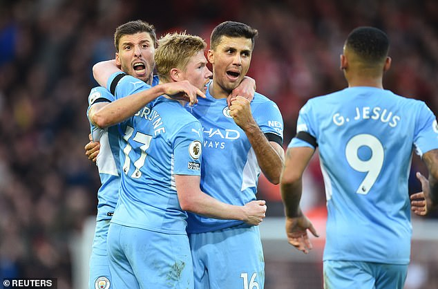 Manchester City secured a battling draw with title rivals Liverpool at Anfield on Sunday