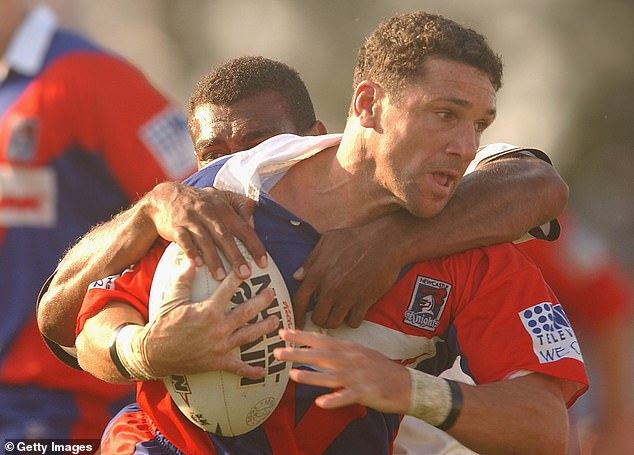 The star credits his mother for much of success on the rugby league field saying she was like a 'human icepack' always there to ease his pain when times got tough (pictured, playing for the Knights in 2002)