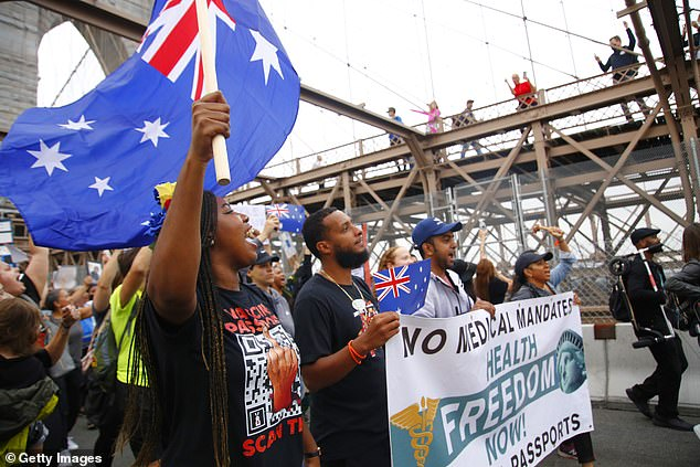 Several protesters waved Australian flags as they chanted 'Save Australia' - in reference to lockdowns and vaccine passports