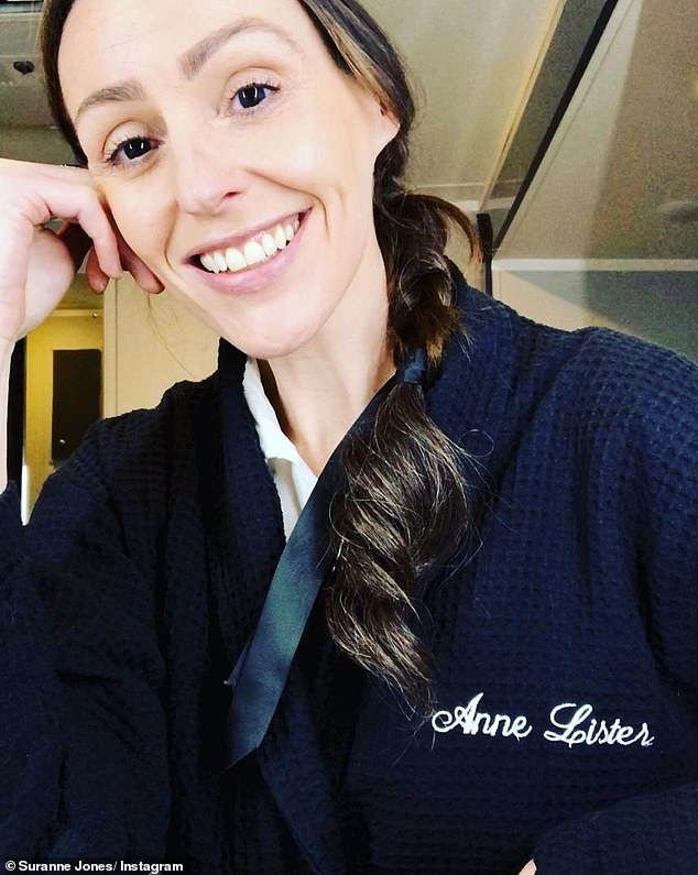 Radiant: In another post, the star is fresh-faced and makeup-free as she smiles at the camera wearing a navy robe emblazoned with her character's name.