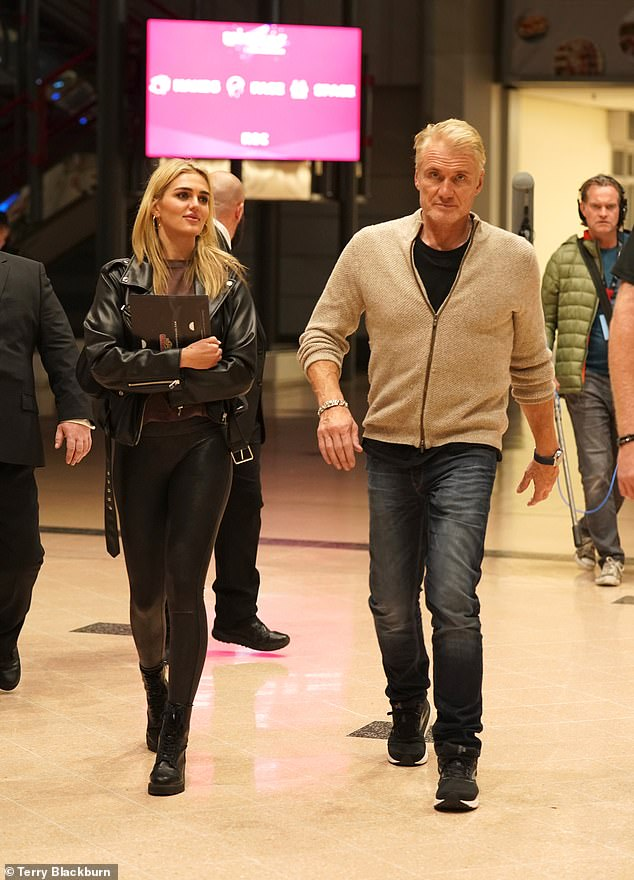 Comfort: Opting for comfort, fitness fanatic Dolph donned trainers while Emma wore stylish lace-up shoes