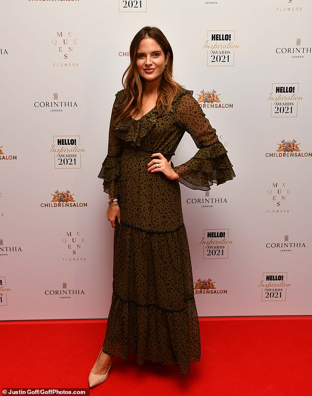 Looking good: The former Made In Chelsea star wore her brunette tresses in soft waves which cascaded over her shoulders for the awards taking place at London's Corinthia Hotel