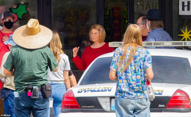 Center of attention: Renee is surrounded by cast and crew while filming the new series