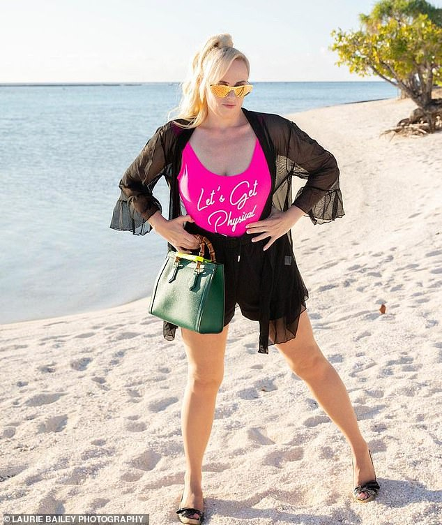 Stylish:The actress and comedian wore tiny black shorts and a bright pink T-shirt with the words 'Let's Get Physical' written on the front