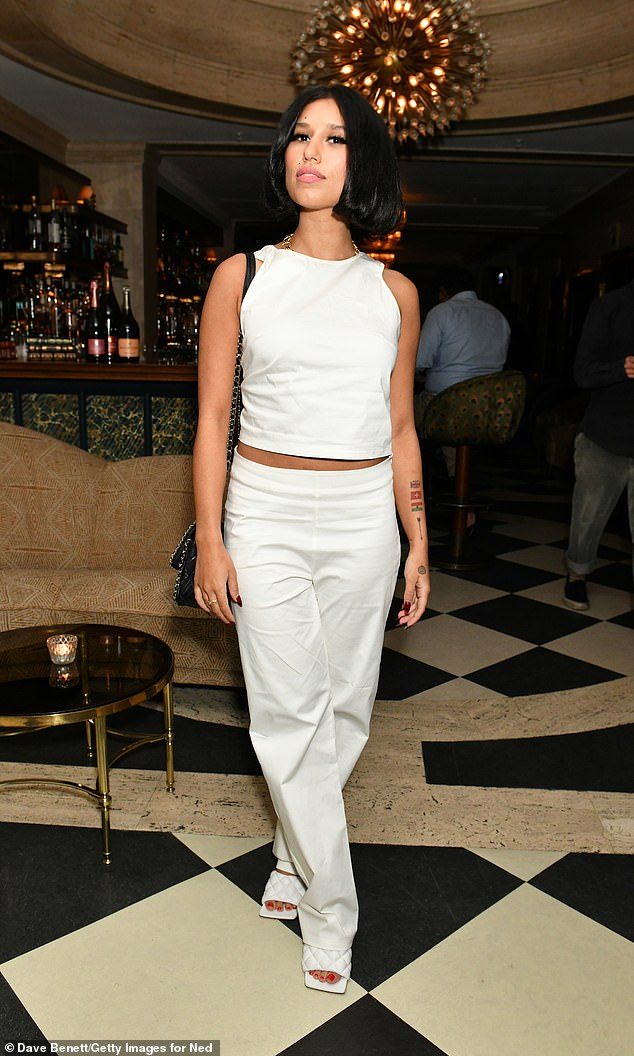 Stunner: She accentuated her height with quilted mules, revealing a clear red pedicure