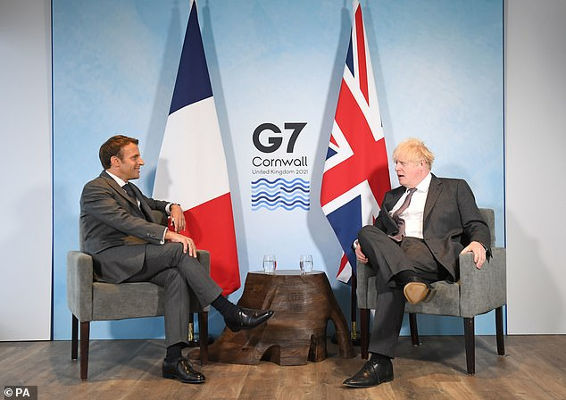 Britain's ties with France and Brussels soured in March when domestic vaccine roll-outs broke ahead of the European Union.  Image: Mr Macron with Prime Minister Boris Johnson at the G7 summit in June