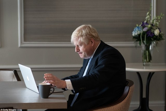 Boris Johnson pictured writing his Conservative Party conference speech at the Midland Hotel in Manchester today