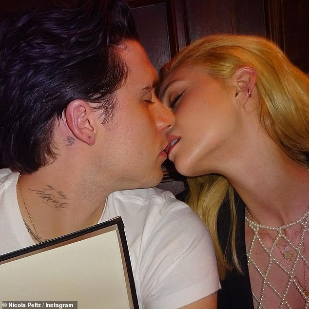 Kiss me!  Nicola Peltz shared yet another love-filled photo of her future husband Brooklyn Beckham at a Paris 'photo dump' on her Instagram page on Monday