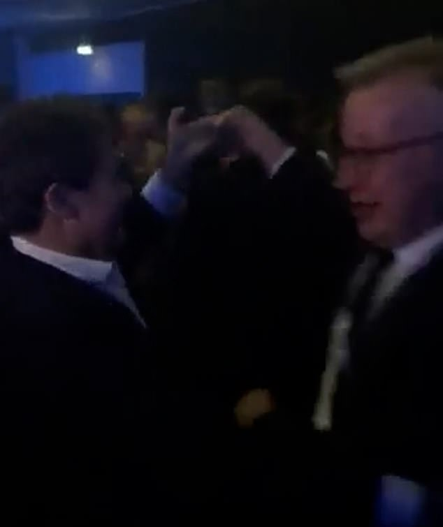 The pair are seen laughing as they dance together on the packed dance floor at the Tory conference in Manchester