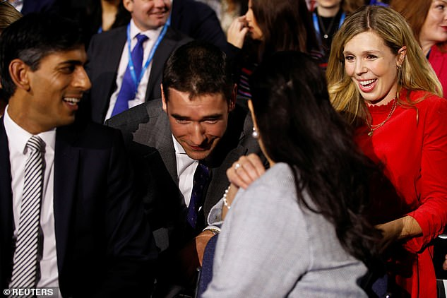 Carrie Johnson, Home Secretary Priti Patel and Britain's Chancellor of the Exchequer Rishi Sunak sit on the conference floor ahead of the PM's speech during the annual Conservative Party Conference in Manchester on October 6, 2021