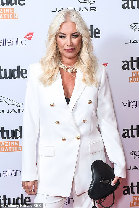 Looking good: The presenter, 47, wowed in her suit which featured stylish button detailing and flared trousers as she posed confidently for the cameras