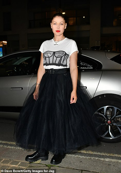 Glam: Emma Willis commanded attention in a puffy black skirt and white T-shirt with a corset design
