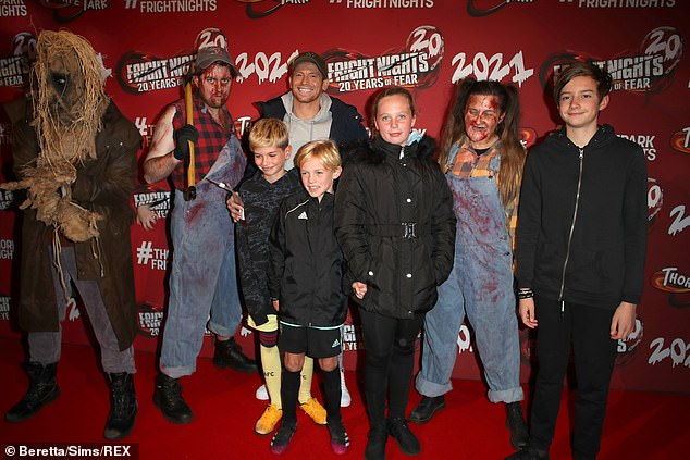 Family Affair: Joe exited a previous relationship with his 14-year-old son Harry, and Stacy's sons Zachary, 13, (right right) and nine-year-old Leighton (middle), out of their previous relationships