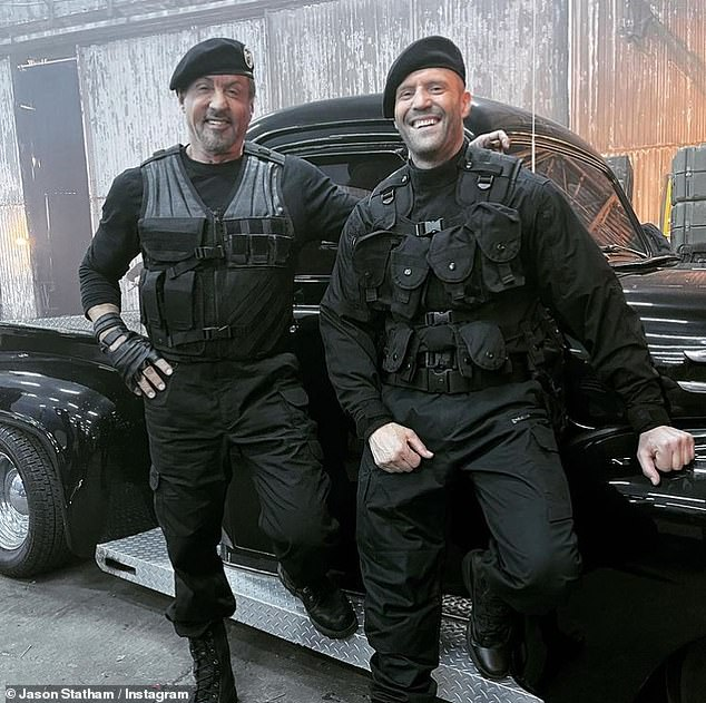 Suave: Sylvester Stallone (left) and Jason Statham (right) look ready for action while posing with each other during the filming of The Expendables 4 in a Wednesday Instagram post.