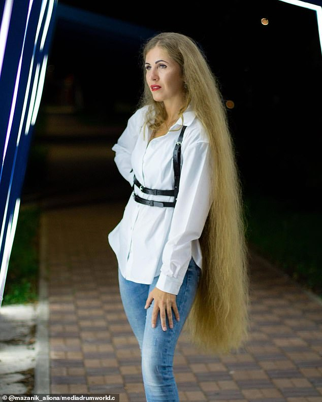 Women often ask Alina, pictured, for advice on how to grow their hair or take care of it.
