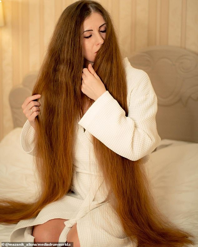 It takes him up to four hours to brush, wash, dry and moisturize his hair three to four times a week.