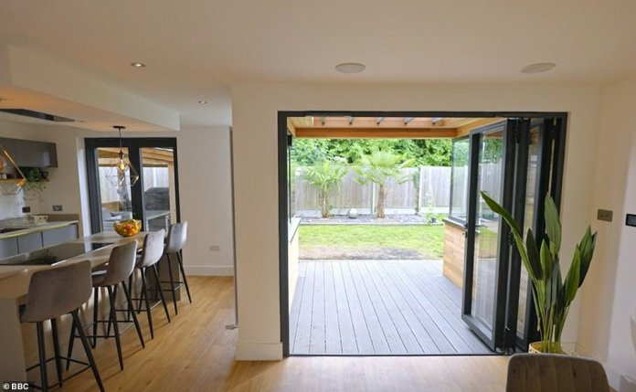 Serious wow factor: Adding a 10 square meter extension to the space behind the house and flipping the layout to create a 'horseshoe' shape (pictured) that allows in more light