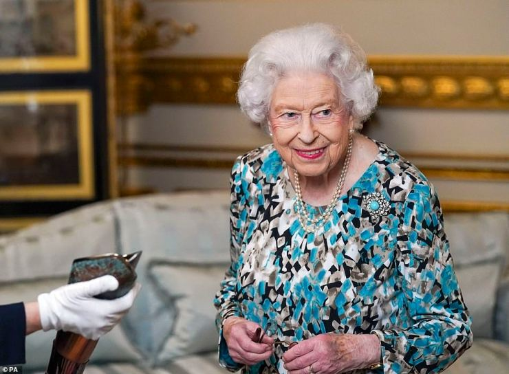 7,500 bearers take the baton on a 90,000-mile journey to all 72 nations and territories of the Commonwealth over 294 days (pictured, the Queen with the baton)