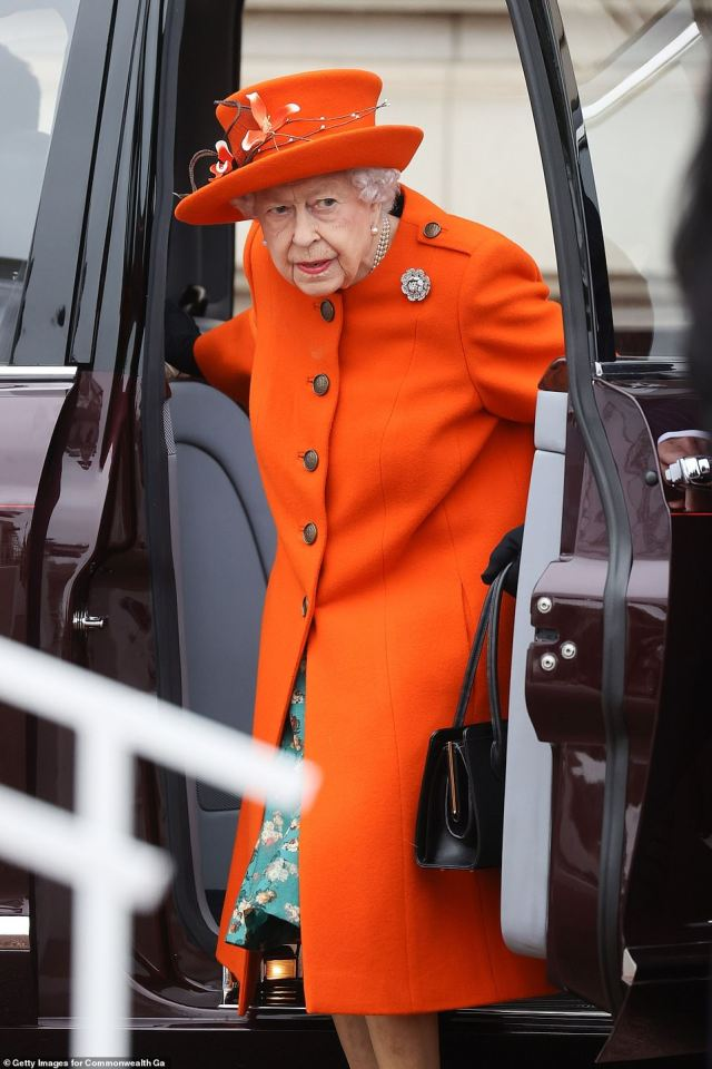 Beneath her vibrant orange coat, which featured brown buttons and military style detailing, the royal wore a green floral skirt