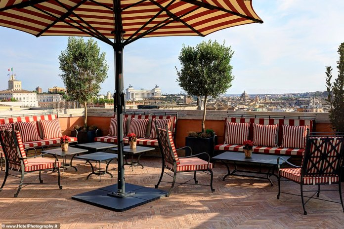 The breakfast on the glamorous Hotel de la Ville rooftop terrace, pictured, is the freshest and best in the city, claims Frank