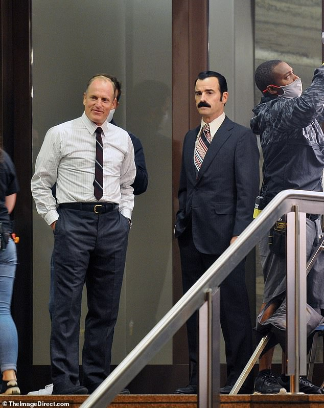 The actor pictured filming outside the Watergate Tuesday with co-star Justin Theroux, the day before he was allegedly attacked