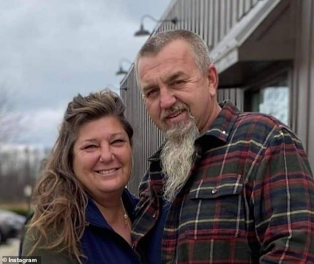 Heroic father Woodrow Slayton (pictured with his wife) was suffering from a burnt foot while driving Laiha's puppy to the veterinarian in a bid to save its life