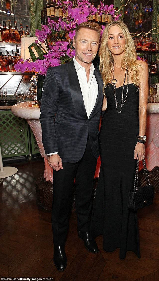 The Couple: His stunning wife Storm, 39, looked ethereal in an onyx maxi dress that displayed her enviable physique.