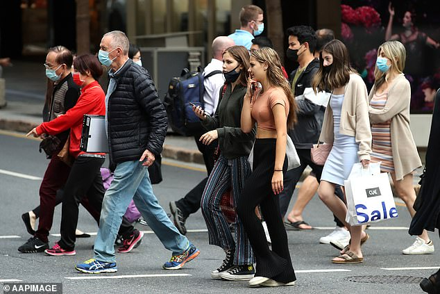 The QLD Premier would not say when the state borders would open, saying they will open when it is safe to do so (pictured: pedestrians wearing masks in Brisbane's CBD)