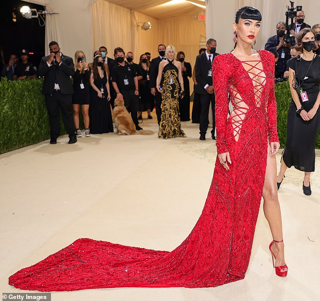 Sizzling: Megan Fox stunned in a red Dundas gown at the Met Gala last month — since sales of lace-up wear have soared 300% at Boohoo