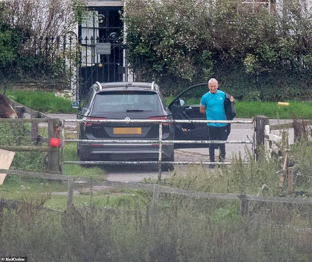 Noye, who was wearing a blue training t-shirt, spoke to Michelle briefly after he arrived at the stables on Thursday afternoon