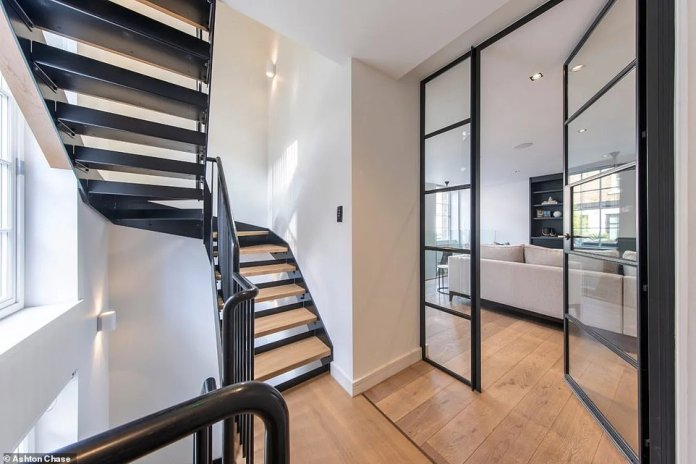 The central London home (pictured) is modern and full of modern amenities including mezzanine floors, lightwells, high ceilings and parquet floors, as well as a home cinema, reception hall and a state-of-the-art kitchen.
