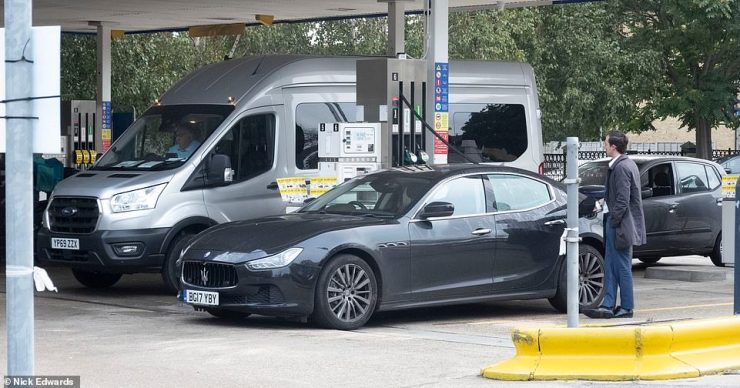 People fill their cars up with fuel at a Tesco petrol station in South East London today