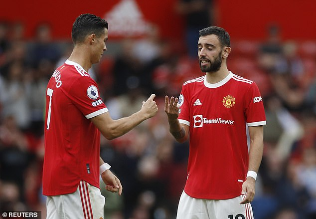That is more than Bruno Fernandes (right) has passed to his Portugal team-mate (left)