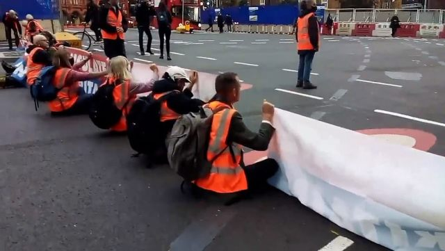 Today they were flanked by as many 'official observers' dressed in high-vis vests after confrontations at other locations