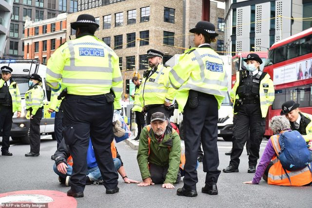 Insulate Britain activists at Old Street today. They also blocked part of the M25 motorway today in defiance of an injunction
