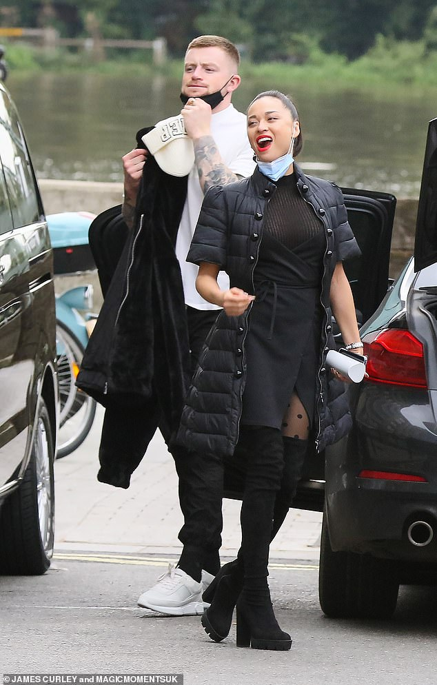 Happy: Katya and her 26-year-old Strictly Dance partner Adam Peaty enjoy a laugh as they head to their It Takes Two TV show