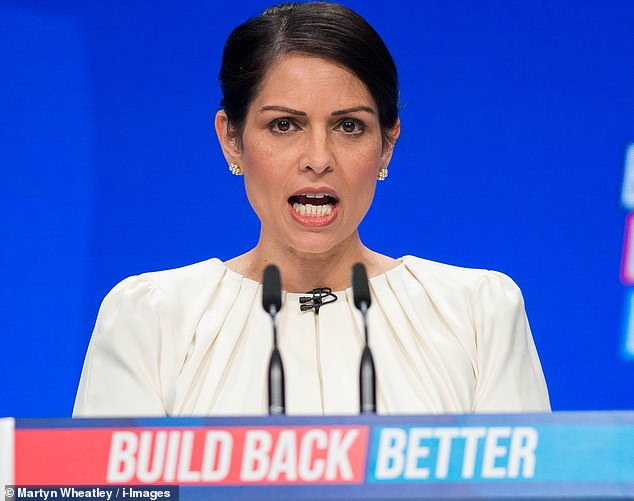Priti Patel, pictured, has authorised a plan to start a phone number and app which could be used to summon help to women walking home who are feeling threatened