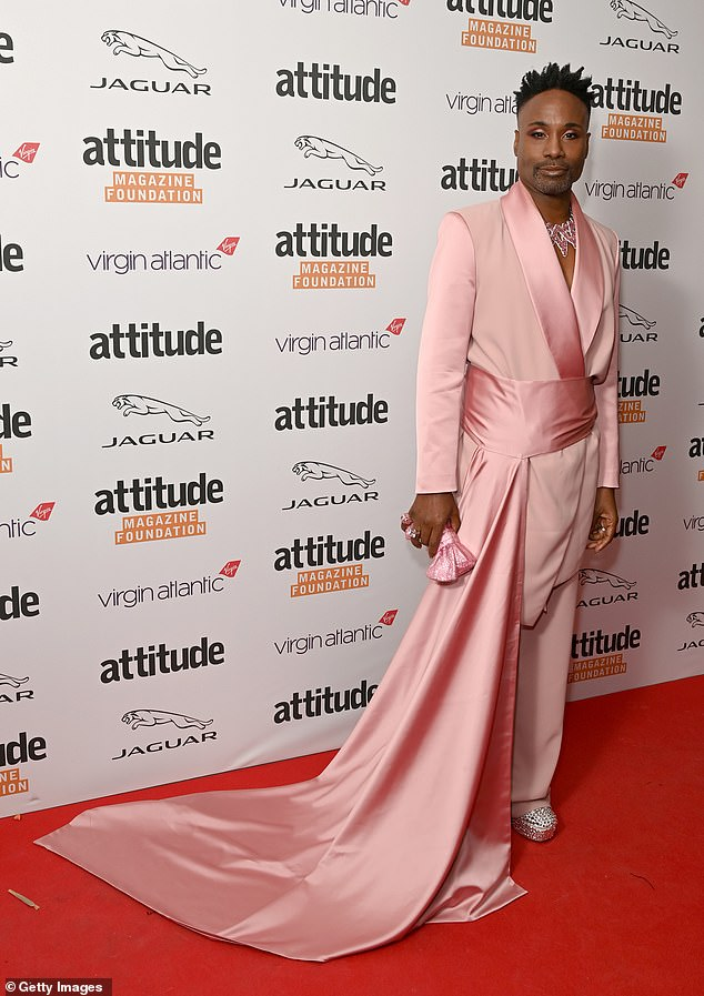 , Duncan James poses in a corset and suspenders with Billy Porter, The Habari News New York